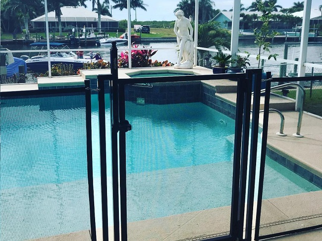 "A 48"" Black Pool Corral Fence with Standard (flat) Self Closing and Self Latching Gate and Magna Lock."